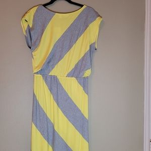 Cato Dress with gray and yellow wide lines.